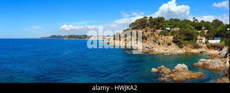 Summer sea rocky coast view (near Lloret de Mar town, Catalonia, Spain). High-resolution three images stitch panorama. - Stock Photo