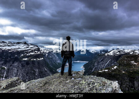 July 22, 2015: Traveller at the edge of Trolltunga, Norway - Stock Photo