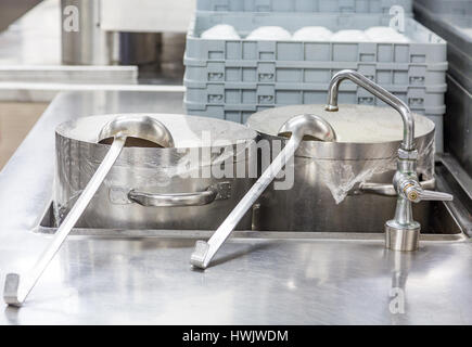 Ladles on Stock Pots in Commercial Kitchen - Stock Photo