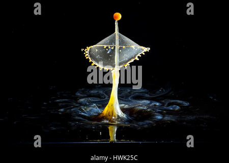 Images forming two drops of water when colliding after falling in water - Stock Photo