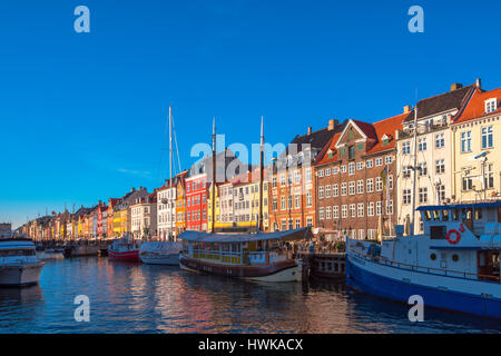 COPENHAGEN, DENMARK - MARCH 11, 2017: Copenhagen Nyhavn canal and promenade with its colorful facades, 17th century - Stock Photo