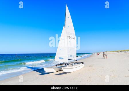 SYLT ISLAND, GERMANY - SEP 9, 2016: Sailing boat on Kampen beach, Sylt island, Germany. - Stock Photo