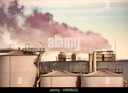 Air Pollution from the smokestack of an old  factory - Stock Photo