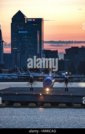 Airplane landing at London City Airport, UK - Stock Photo