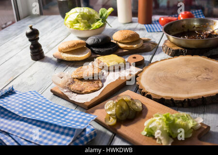 Table with burger ingredients. - Stock Photo