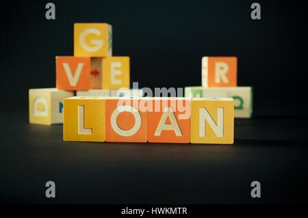 LOAN word with colorful blocks. loan word debt forecasting money financial cube repaying concept - Stock Photo