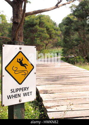 Sign 'Slippery when wet'  in a park, Australia 2016 - Stock Photo