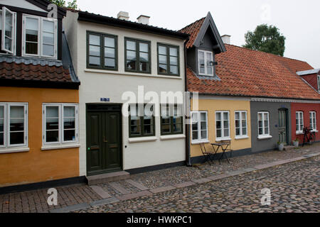 Ancient houses in the old town center of the city of Odense, Funen, Denmark - Stock Photo