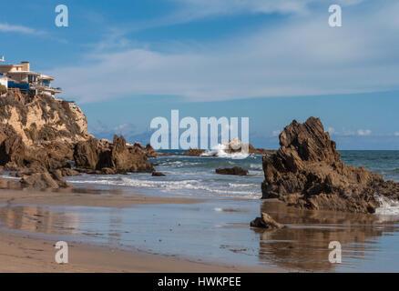 Waves crashing on rocky coastline Newport Beach California - Stock Photo