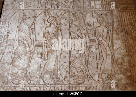 Enemies of ancient Egypt depicted standing on tiptoes on the floor of the Great  Hypostyle Hall at Karnak Temple - Stock Photo