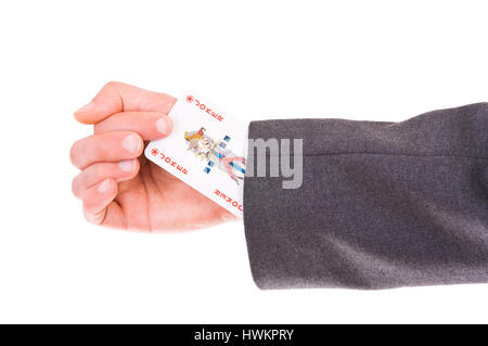 Businessman with Joker card hidden under sleeve. - Stock Photo