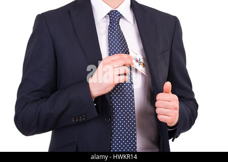 Businessman putting joker card in his pocket. - Stock Photo