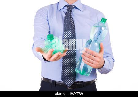 Businessman holding green bottles.