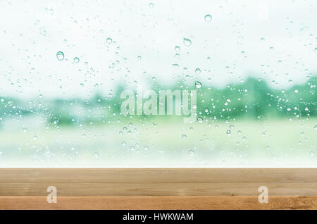 Empty wooden table top with glass wall and water drop background. can be used product display. - Stock Photo