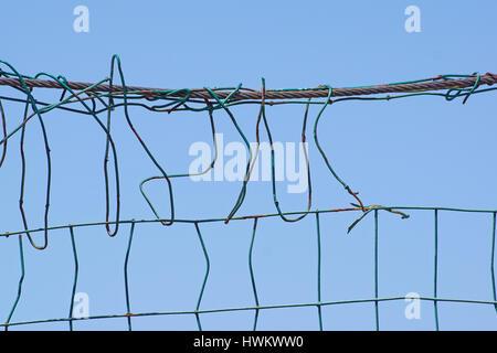 damaged wire mesh - Stock Photo