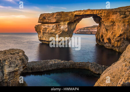 Gozo, Malta - The beautiful Azure Window, a natural arch and famous landmark on the island of Gozo at sunset - Stock Photo