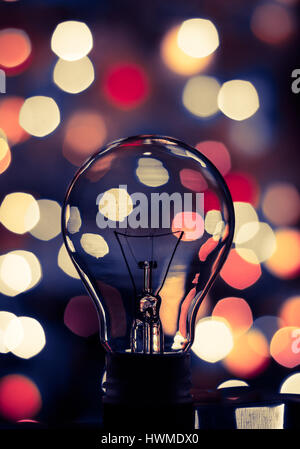 Light bulb bokeh. Abstract photo of a light bulb with colorful bokeh background. - Stock Photo