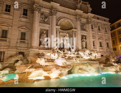 The Trevi Fountain  (Fontana di Trevi)  by night.  Pietro Bracci's statue, Oceanus (god of all water) is seen in - Stock Photo