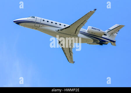 Galaxy G-200 personal executive jet over the skies of Sarasota SRQ airport in Florida - Stock Photo