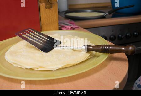 Preparing pancakes for dinner - Stock Photo