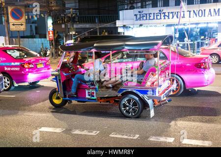Auto rickshaw (tuk-tuk) at night on the streets of Bangkok, Thailand - Stock Photo