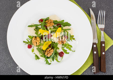 Vegetarian salad with pear, arugula and walnuts - Stock Photo