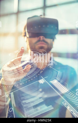 Digitally generated image of volume knob with graphical data against male business executive using virtual reality - Stock Photo