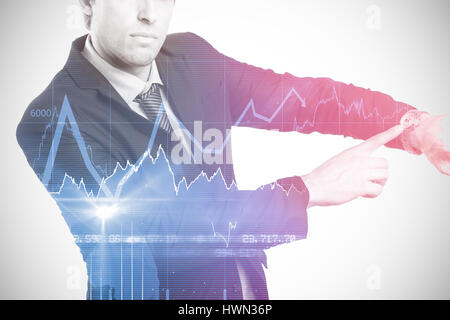 Portrait of serious businessman showing wristwatch against stocks and shares 3d - Stock Photo