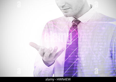 Businessman using futuristic mobile phone against compass pointing to success 3d - Stock Photo