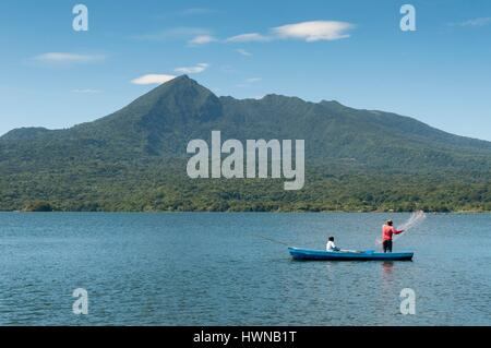 Nicaragua, Granada district, Granada, Las Isletas, fisherman throwing his net on Lake Nicaragua, Mombacho volcano - Stock Photo