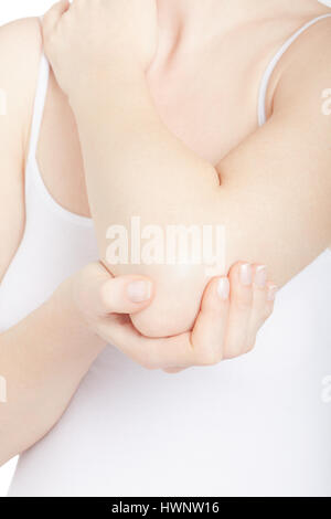 Woman in white shirt with elbow in pain isolated on white, clipping path - Stock Photo