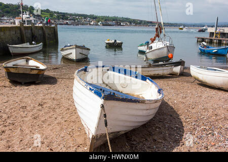 Boats on The Estuary Beach and Moored in the Teign Estuary with View of Shaldon Bridge: Teignmouth, Devon, England. - Stock Photo