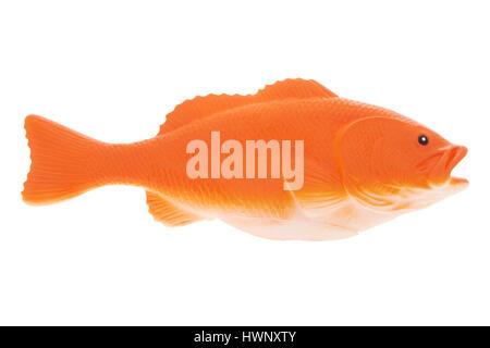 Plastic fish on white background - Stock Photo