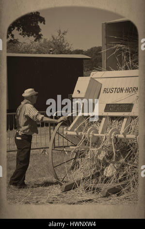 Demonstrating old farm machinery at the New Forest Show Hampshire UK - Stock Photo