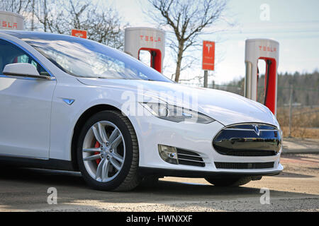 PAIMIO, FINLAND - MARCH 18, 2017: Detail of white Tesla Model S P85D electric car which is being charged at Tesla - Stock Photo