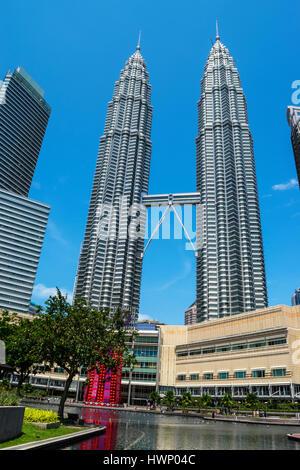 The Petronas Twin Towers and Suria KLCC Shopping Mall, Kuala Lumpur,   Malaysia - Stock Photo