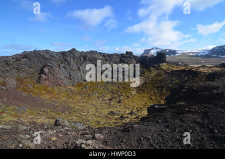 Iceland's Eldborg Crater with moss covered lava rock. - Stock Photo