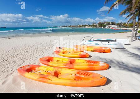 Kayaks on Playa del Carmen sand beach in Mexico - Stock Photo