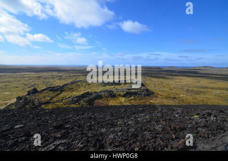 Moss covered lava field surrounding Eldborg Crater in Iceland. - Stock Photo
