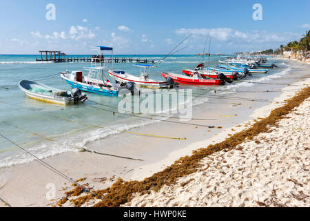 Fishing boats on the beach of Playa del Carmen in Mexico - Stock Photo