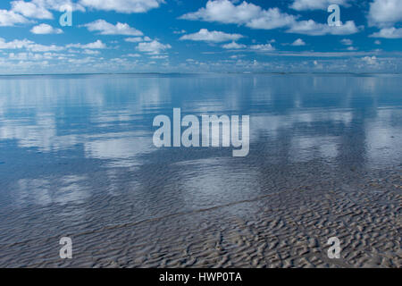 Beach Vacations: Patacho Beach, Alagoas, Brazil, considered one of the most beautiful beaches in Brazil - Sand, sky and sea with beautiful reflection. Stock Photo
