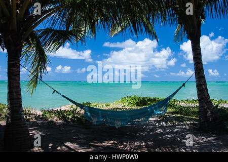 Beach Vacations: Patacho Beach, Alagoas, Brazil, considered one of the most beautiful beaches in Brazil - Turquoise sea with blue hammock Stock Photo
