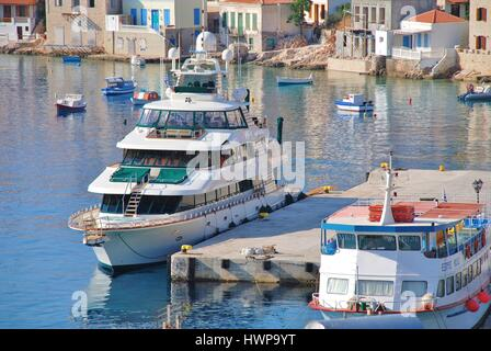 Luxury super yacht Forty Love moored at Emborio harbour on the Greek island of Halki. The 42.06mtr vessel was built - Stock Photo
