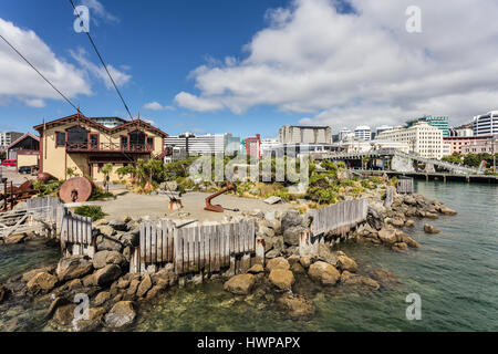 Waterfront promenade in Wellington, New Zealand capital city on a sunny summer day with the business district skyline - Stock Photo