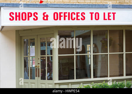 Cirencester - Shops & Offices to let sign on empty shop at Cirencester, Gloucestershire in March - Stock Photo