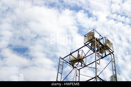 outdoor speaker on movable structure for public relation on cloudy day - Stock Photo
