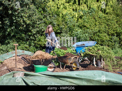 The Land Gardeners Henrietta Courtauld (pictured) and Bridget Elworthy making compost at Wardington Manor near Banbury, - Stock Photo