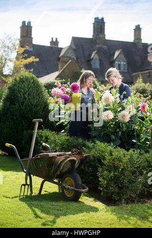 Re. The Land Gardeners Henrietta Courtauld and Bridget Elworthy making compost at Wardington Manor near Banbury, - Stock Photo