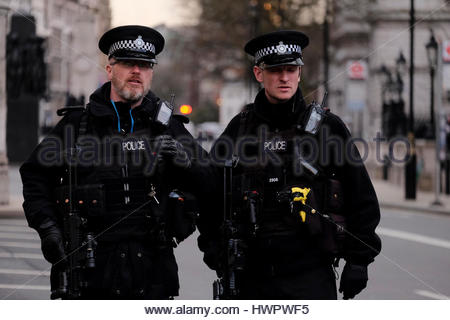 London, UK. 22nd Mar, 2017.  Metropolitan police firearms officers stand guard in a deserted Whitehall following - Stock Photo