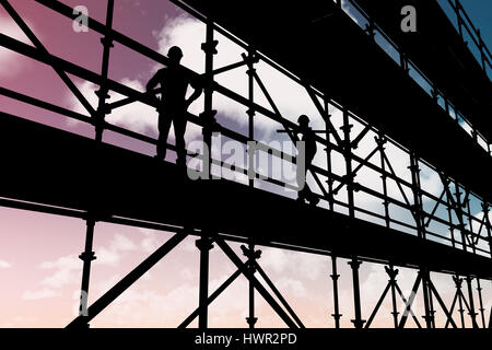 Smiling worker carrying wooden planks against blue sky 3d - Stock Photo